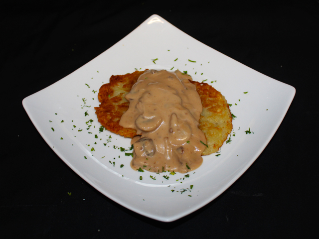 Fried potato pancakes with mushroom sauce (v)
