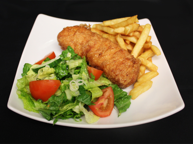 CCCP Chicken Kiev served with chips and seasonal salad
