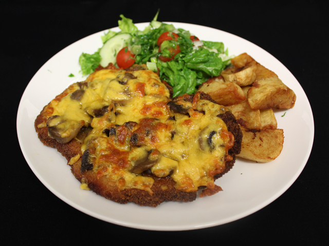 Breaded pork loin topped with mushroom and cheese