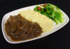 Venison stew served with mashed potato