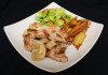 Wild boar plait with apple slices in creamy sauce served with saute potatoes and seasonal salad.