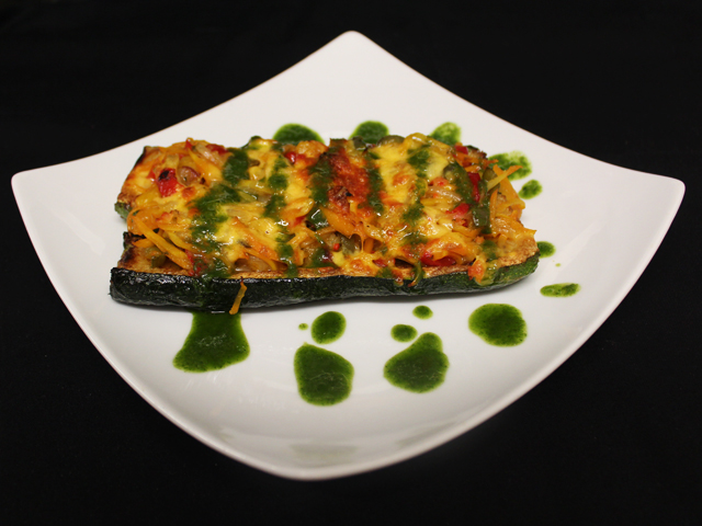 Stuffed zucchini with vegetables and cheese (v)