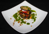 Aubergine tower, served with basil sauce and walnuts