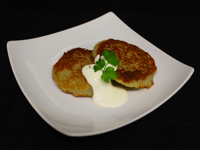 Fried potato pancakes, stuffed with minced pork and drizzled £7.99 with sour cream
