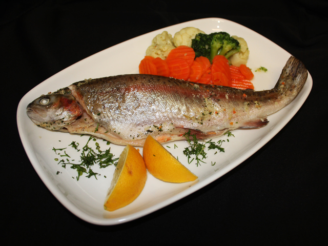 Whole trout served with steamed seasonal vegetables