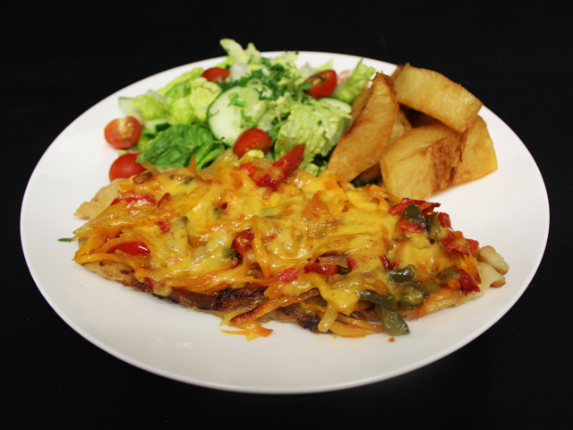 White fish baked with vegetables and cheese