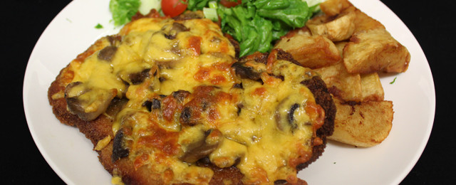 Breaded chicken breast topped with mushrooms and cheese