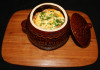casserole of pork, onion, paprika, mushroom, baked egg