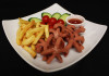Sausages and chips, served with seasonal salad